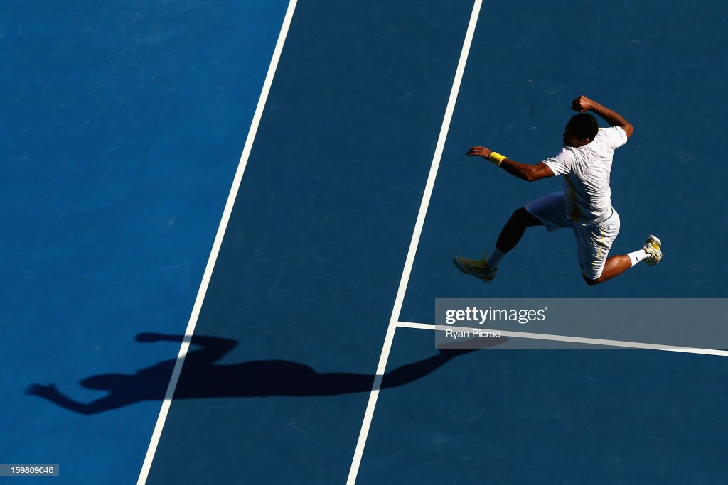Jo-Wilfried Tsonga of France celebrates winning his fourth round match against Richard Gasquet of France during day eight of the 2013 Australian Open at Melbourne Park on January 21, 2013 in Melbourne, Australia.
