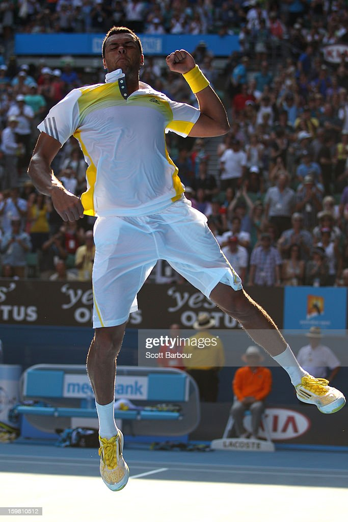 <a gi-track='captionPersonalityLinkClicked' href=/galleries/search?phrase=Jo-Wilfried+Tsonga&family=editorial&specificpeople=553803 ng-click='$event.stopPropagation()'>Jo-Wilfried Tsonga</a> of France celebrates winning his fourth round match against Richard Gasquet of France during day eight of the 2013 Australian Open at Melbourne Park on January 21, 2013 in Melbourne, Australia.