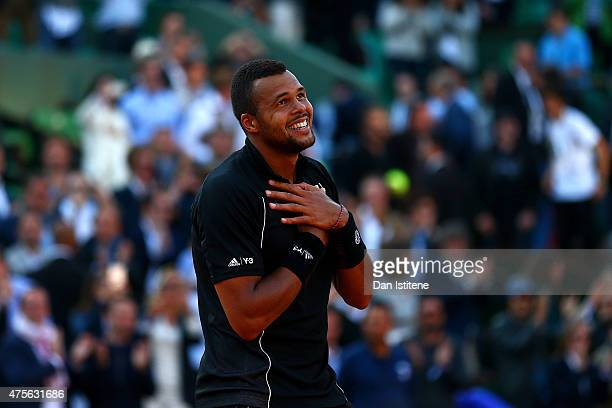 JoWilfried Tsonga of France celebrates winning the match in his Men's quarter final match against Kei Nishikori of Japan on day of the 2015 French...