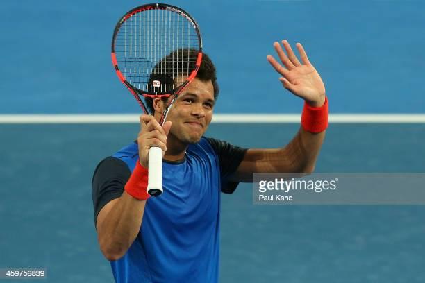 JoWilfried Tsonga of France celebrates winning the mixed doubles match partnered with Alize Cornet against Petra Kvitova and Radek Stepanek of the...