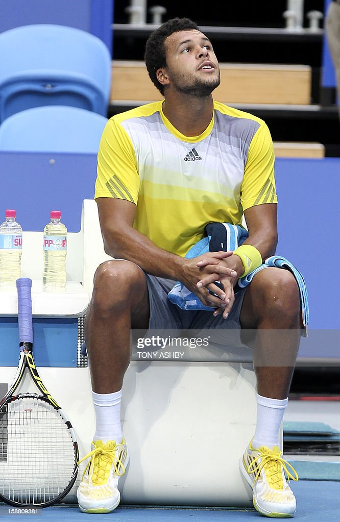 Jo-Wilfried Tsonga of France chats to the umpire during a break in playing against Fernando Verdasco of Spain during their fourth session men's singles match on day two of the Hopman Cup Tennis Tournament in Perth on December 30, 2012. Tsonga won the match 7-5, 6-3. AFP PHOTO/Tony ASHBY. IMAGE STRICTLY RESTRICTED TO EDITORIAL USE-STRICTLY NO COMMERCIAL USE.