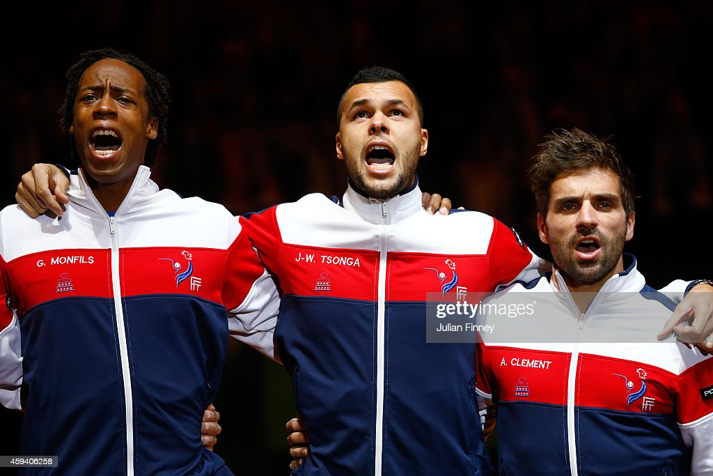 <a gi-track='captionPersonalityLinkClicked' href=/galleries/search?phrase=Jo-Wilfried+Tsonga&family=editorial&specificpeople=553803 ng-click='$event.stopPropagation()'>Jo-Wilfried Tsonga</a> of France, <a gi-track='captionPersonalityLinkClicked' href=/galleries/search?phrase=Gael+Monfils&family=editorial&specificpeople=213774 ng-click='$event.stopPropagation()'>Gael Monfils</a> of France and Captain <a gi-track='captionPersonalityLinkClicked' href=/galleries/search?phrase=Arnaud+Clement&family=editorial&specificpeople=203192 ng-click='$event.stopPropagation()'>Arnaud Clement</a> of France sing the national anthem during day two of the Davis Cup Tennis Final between France and Switzerland at the Stade Pierre Mauroy on November 22, 2014 in Lille, France.