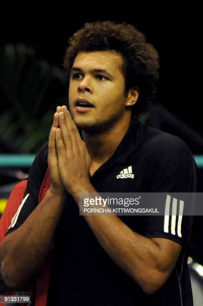 JoWilfried Tsonga of France gives a traditional greeting to his fans after beating Macro Chiudinelli of Switzerland during their quarterfinal round...