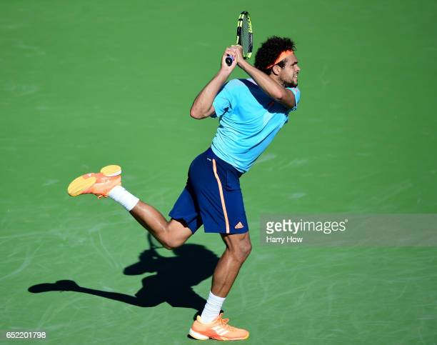 JoWilfried Tsonga of France hits a backhand in his loss to Fabio Fognini of Italy during the BNP Paribas Open at Indian Wells Tennis Garden on March...