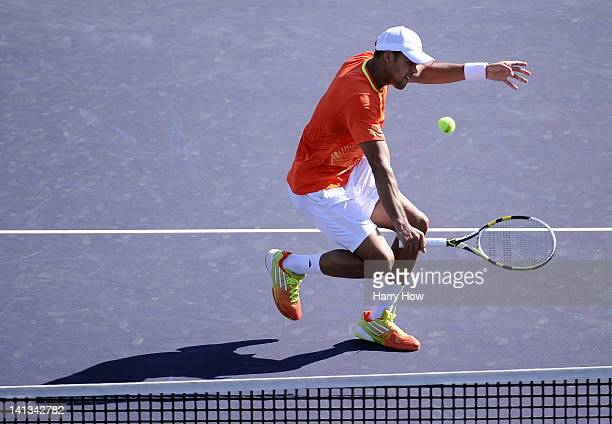 JoWilfried Tsonga of France hits a backhand volley during his match against David Nalbandian of Argentina at the Indian Wells Tennis Garden on March...