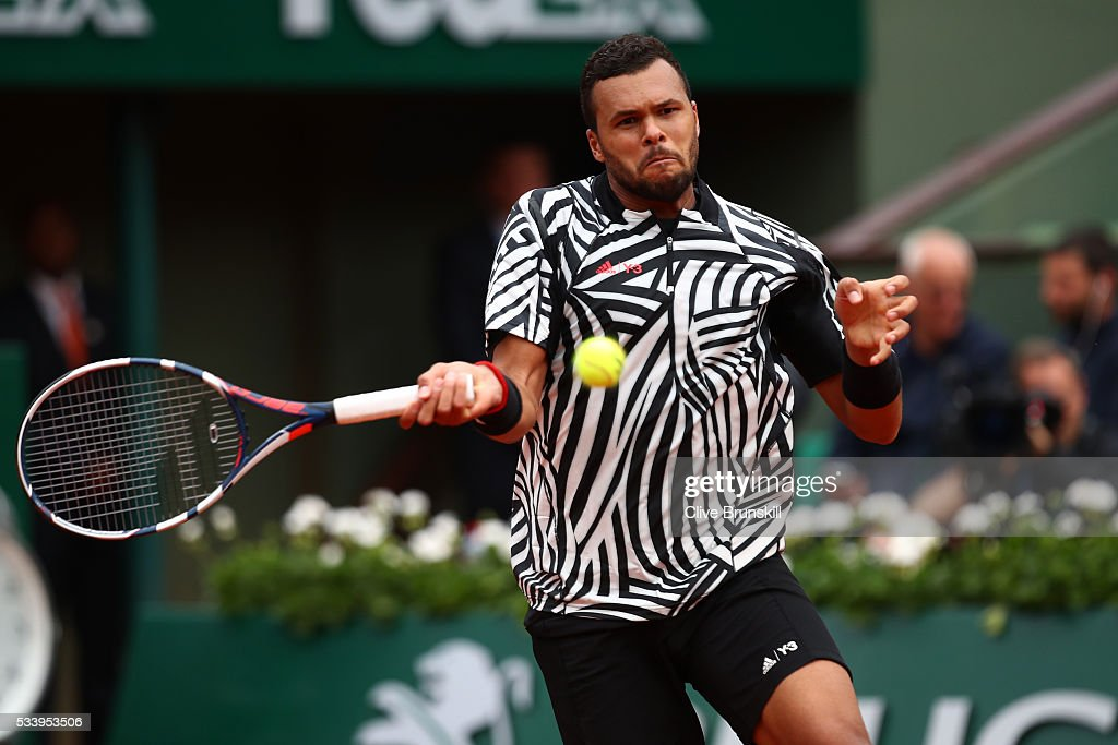 <a gi-track='captionPersonalityLinkClicked' href=/galleries/search?phrase=Jo-Wilfried+Tsonga&family=editorial&specificpeople=553803 ng-click='$event.stopPropagation()'>Jo-Wilfried Tsonga</a> of France hits a forehand during the Men's Singles first round match against Jan-Lennard Struff of Germany on day three of the 2016 French Open at Roland Garros on May 24, 2016 in Paris, France.