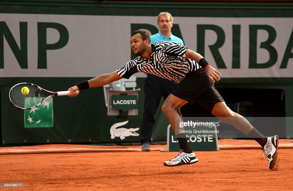 <a gi-track='captionPersonalityLinkClicked' href=/galleries/search?phrase=Jo-Wilfried+Tsonga&family=editorial&specificpeople=553803 ng-click='$event.stopPropagation()'>Jo-Wilfried Tsonga</a> of France hits a forehand during the Men's Singles second round match against Marcos Baghdatis of Cyprus on day five of the 2016 French Open at Roland Garros on May 26, 2016 in Paris, France.