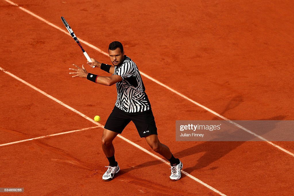 <a gi-track='captionPersonalityLinkClicked' href=/galleries/search?phrase=Jo-Wilfried+Tsonga&family=editorial&specificpeople=553803 ng-click='$event.stopPropagation()'>Jo-Wilfried Tsonga</a> of France hits a forehand during the Men's Singles third round match against Ernests Gulbis of Latvia on day seven of the 2016 French Open at Roland Garros on May 28, 2016 in Paris, France.