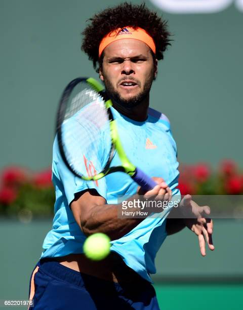 JoWilfried Tsonga of France hits a forehand in his loss to Fabio Fognini of Italy during the BNP Paribas Open at Indian Wells Tennis Garden on March...