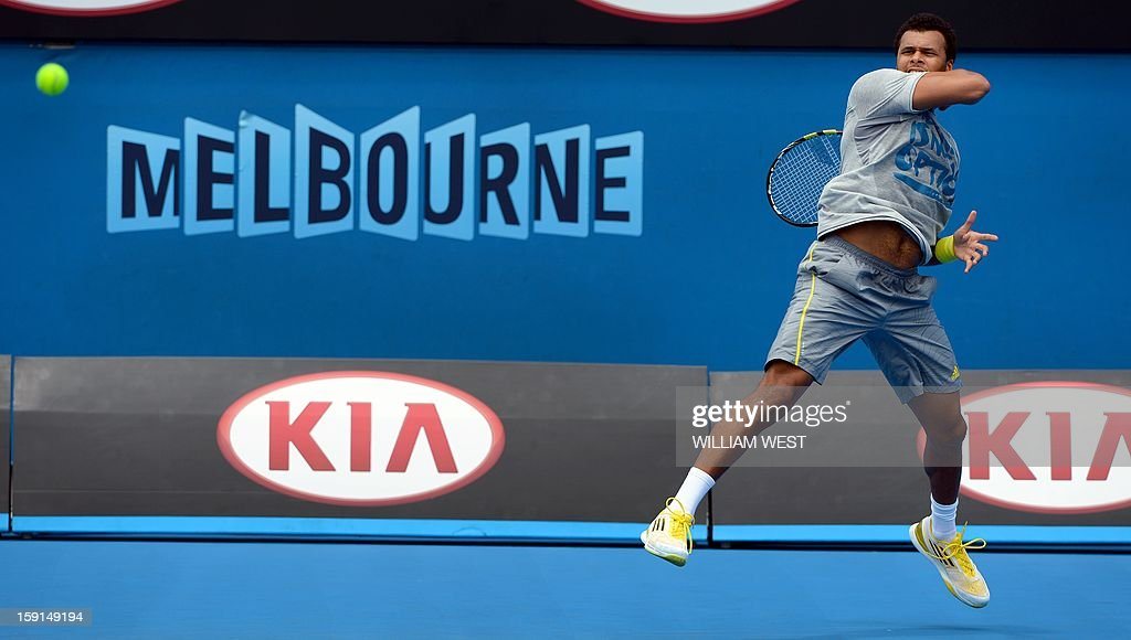 Jo-Wilfried Tsonga of France hits a forehand return during a training session at Melbourne Park on January 9, 2013. Top players are arriving in Melbourne ahead of the Australian Open which runs from January 14 to 27. AFP PHOTO / William WEST USE
