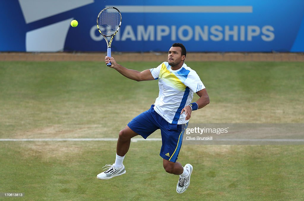 <a gi-track='captionPersonalityLinkClicked' href=/galleries/search?phrase=Jo-Wilfried+Tsonga&family=editorial&specificpeople=553803 ng-click='$event.stopPropagation()'>Jo-Wilfried Tsonga</a> of France hits a forehand shot during the Men's Singles semi final round match against Andy Murray of Great Britain on day six of the AEGON Championships at Queens Club on on June 15, 2013 in London, England.