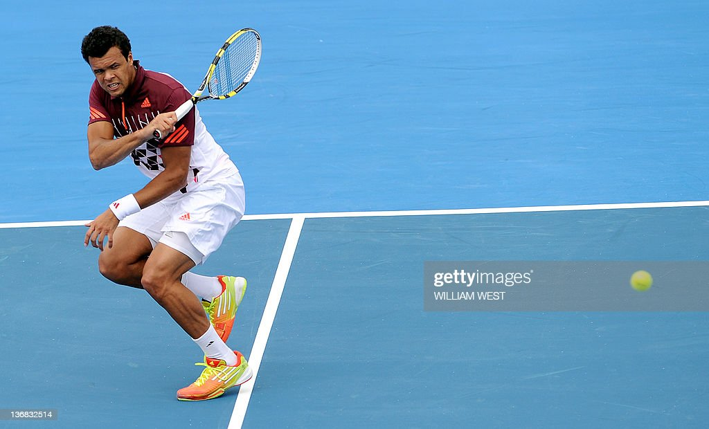 JoWilfried Tsonga of France hits a return during his match against Kei Nishikori of Japan at the Kooyong Classic tennis tournament in Melbourne on...