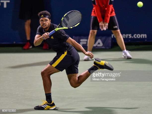 JoWilfried Tsonga of France hits a return shot against Sam Querrey of the United States during day six of the Rogers Cup presented by National Bank...
