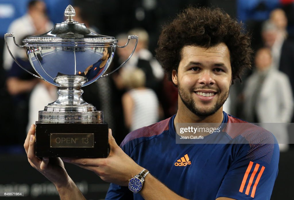 Jo-Wilfried Tsonga of France holds the trophy after beating Lucas Pouille of France in the final of the Open 13, an ATP 250 tennis tournament at Palais des Sports on February 26, 2017 in Marseille, France.