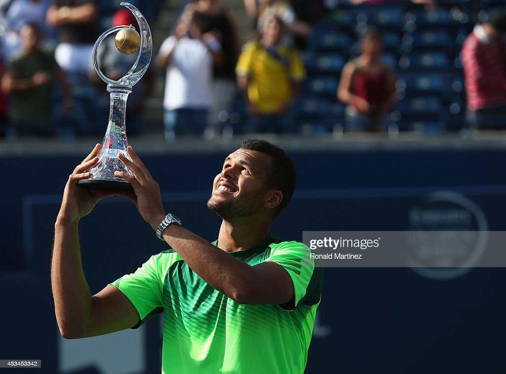Jo-Wilfried Tsonga of France holds up the Rogers Cup trophy after his win against Roger Federer of Switzerland during Rogers Cup at Rexall Centre at York University on August 10, 2014 in Toronto, Canada.