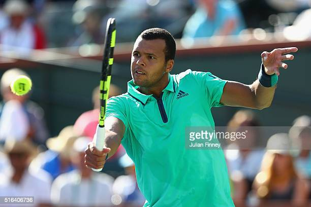 JoWilfried Tsonga of France in action against Novak Djokovic of Serbia during day twelve of the BNP Paribas Open at Indian Wells Tennis Garden on...