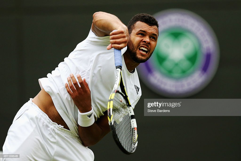 Jo-Wilfried Tsonga of France in action during his Gentlemen's Singles first round match against Jurgen Melzer of Austria on day one of the Wimbledon Lawn Tennis Championships at the All England Lawn Tennis and Croquet Club at Wimbledon on June 23, 2014 in London, England.