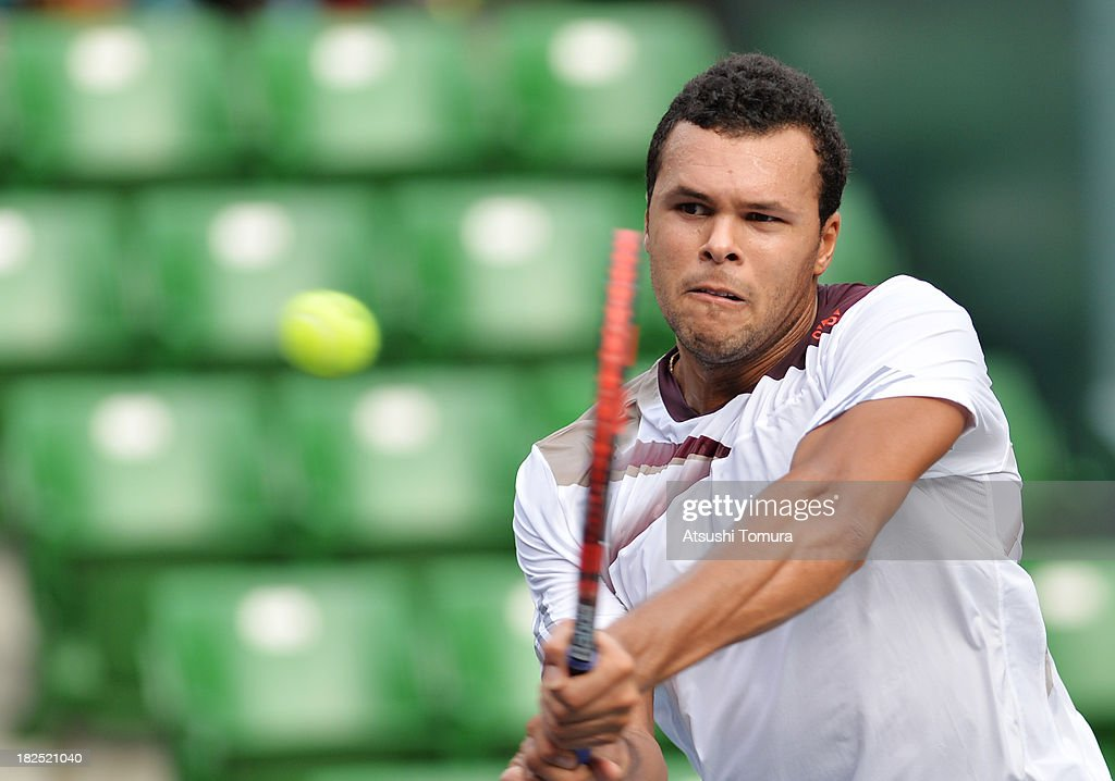 <a gi-track='captionPersonalityLinkClicked' href=/galleries/search?phrase=Jo-Wilfried+Tsonga&family=editorial&specificpeople=553803 ng-click='$event.stopPropagation()'>Jo-Wilfried Tsonga</a> of France in action during his men's first round match against Gael Monfils of France during day one of the Rakuten Open at Ariake Colosseum on September 30, 2013 in Tokyo, Japan.