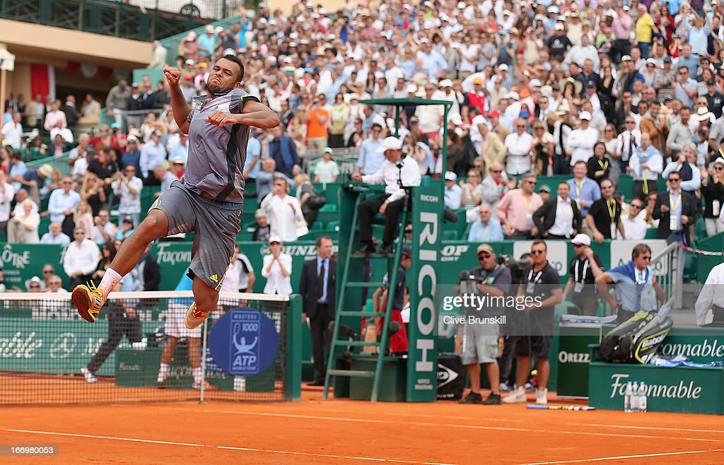 <a gi-track='captionPersonalityLinkClicked' href=/galleries/search?phrase=Jo-Wilfried+Tsonga&family=editorial&specificpeople=553803 ng-click='$event.stopPropagation()'>Jo-Wilfried Tsonga</a> of France leaps into the air to celebrate his three set victory against Stanislas Wawrinka of Switzerland in their quarter final match during day six of the ATP Monte Carlo Masters,at Monte-Carlo Sporting Club on April 19, 2013 in Monte-Carlo, Monaco.
