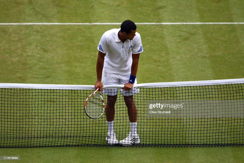 <a gi-track='captionPersonalityLinkClicked' href=/galleries/search?phrase=Jo-Wilfried+Tsonga&family=editorial&specificpeople=553803 ng-click='$event.stopPropagation()'>Jo-Wilfried Tsonga</a> of France looks dejected during his quarterfinal round match against Roger Federer of Switzerland on Day Nine of the Wimbledon Lawn Tennis Championships at the All England Lawn Tennis and Croquet Club on June 29, 2011 in London, England.