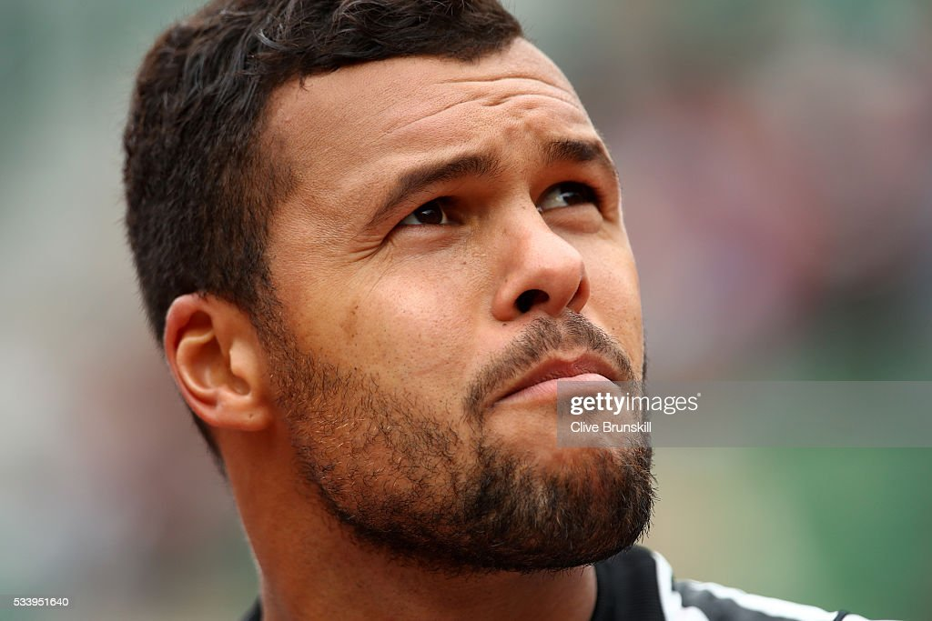 Jo-Wilfried Tsonga of France looks on during the Men's Singles first round match against Jan-Lennard Struff of Germany on day three of the 2016 French Open at Roland Garros on May 24, 2016 in Paris, France.
