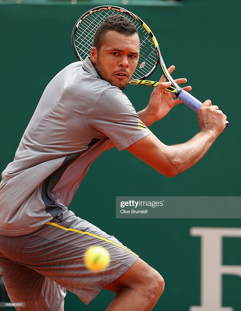 Jo-Wilfried Tsonga of France playa a backhand against Stanislas Wawrinka of Switzerland in their quarter final match during day six of the ATP Monte Carlo Masters,at Monte-Carlo Sporting Club on April 19, 2013 in Monte-Carlo, Monaco.