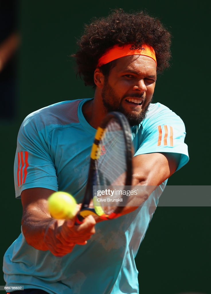 Jo-Wilfried Tsonga of France plays a backhand against Adrian Mannarino of France in his second round match on day three of the Monte Carlo Rolex Masters at Monte-Carlo Sporting Club on April 18, 2017 in Monte-Carlo, Monaco.