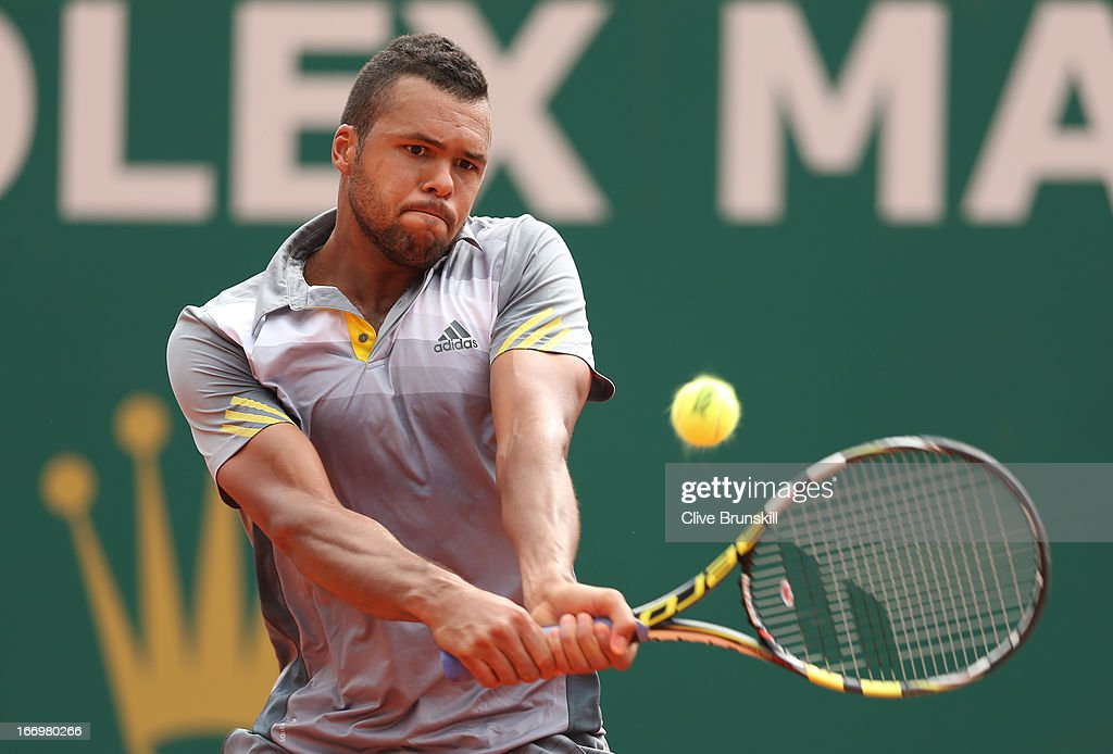 Jo-Wilfried Tsonga of France plays a backhand against Stanislas Wawrinka of Switzerland in their quarter final match during day six of the ATP Monte Carlo Masters,at Monte-Carlo Sporting Club on April 19, 2013 in Monte-Carlo, Monaco.