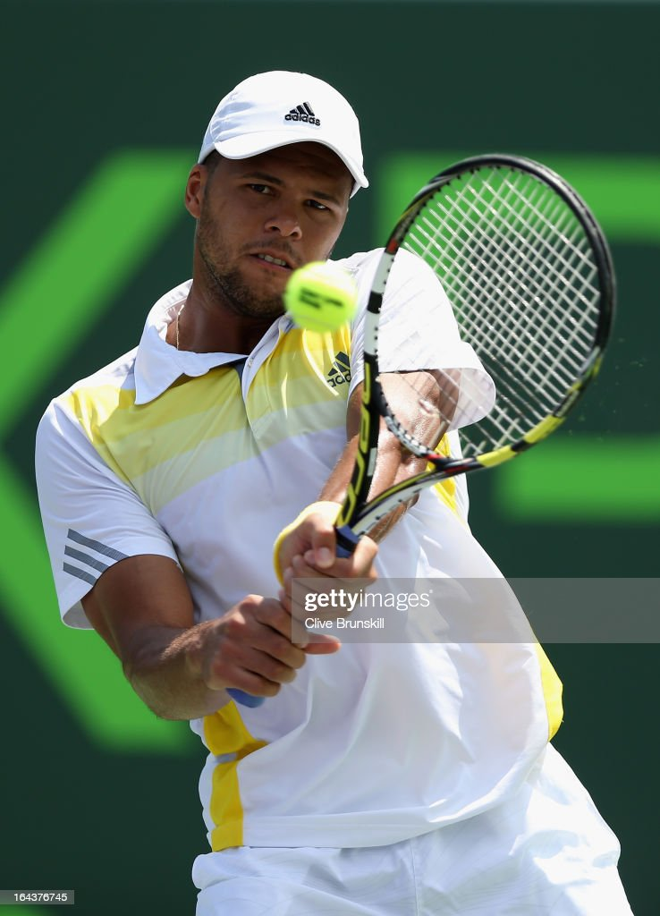 <a gi-track='captionPersonalityLinkClicked' href=/galleries/search?phrase=Jo-Wilfried+Tsonga&family=editorial&specificpeople=553803 ng-click='$event.stopPropagation()'>Jo-Wilfried Tsonga</a> of France plays a backhand against ViktorTroicki of Serbia during their second round match at the Sony Open at Crandon Park Tennis Center on March 23, 2013 in Key Biscayne, Florida.