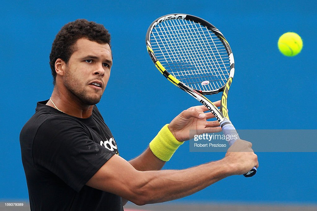Jo-Wilfried Tsonga of France plays a backhand ahead of the 2013 Australian Open at Melbourne Park on January 13, 2013 in Melbourne, Australia.
