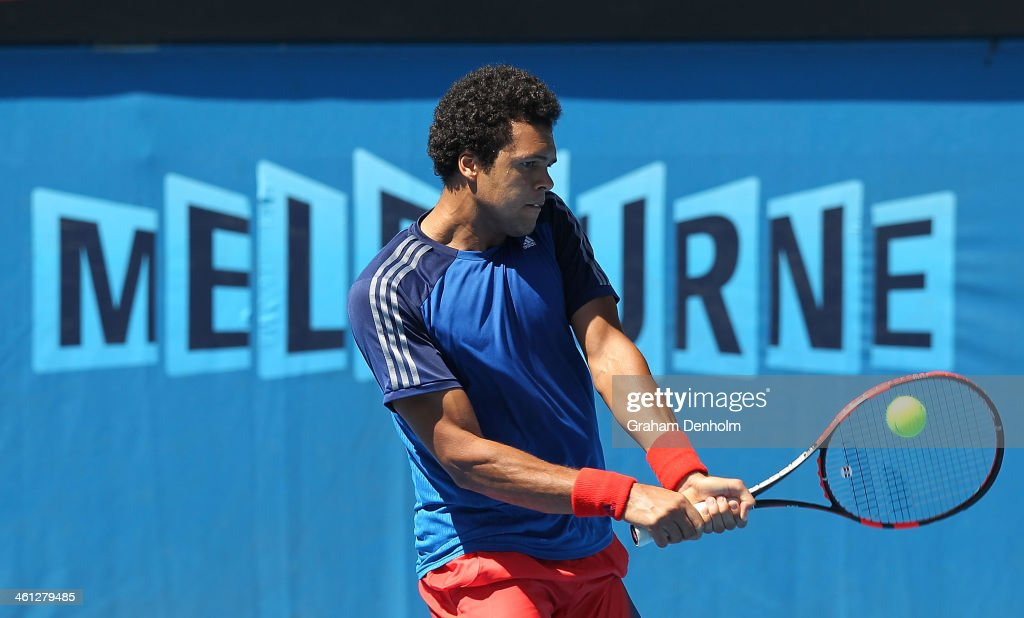 <a gi-track='captionPersonalityLinkClicked' href=/galleries/search?phrase=Jo-Wilfried+Tsonga&family=editorial&specificpeople=553803 ng-click='$event.stopPropagation()'>Jo-Wilfried Tsonga</a> of France plays a backhand during a practice session ahead of the 2014 Australian Open at Melbourne Park on January 8, 2014 in Melbourne, Australia.