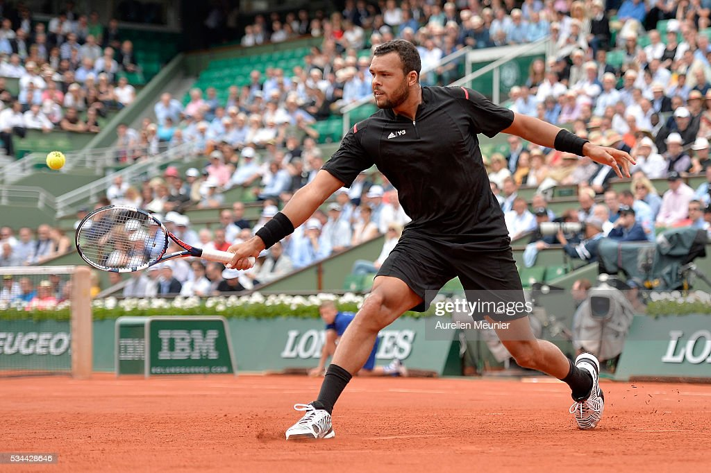 <a gi-track='captionPersonalityLinkClicked' href=/galleries/search?phrase=Jo-Wilfried+Tsonga&family=editorial&specificpeople=553803 ng-click='$event.stopPropagation()'>Jo-Wilfried Tsonga</a> of France plays a backhand during his men's single second round match against Marcos Baghaditis of Cyprus on day five of the 2016 French Open at Roland Garros on May 26, 2016 in Paris, France.