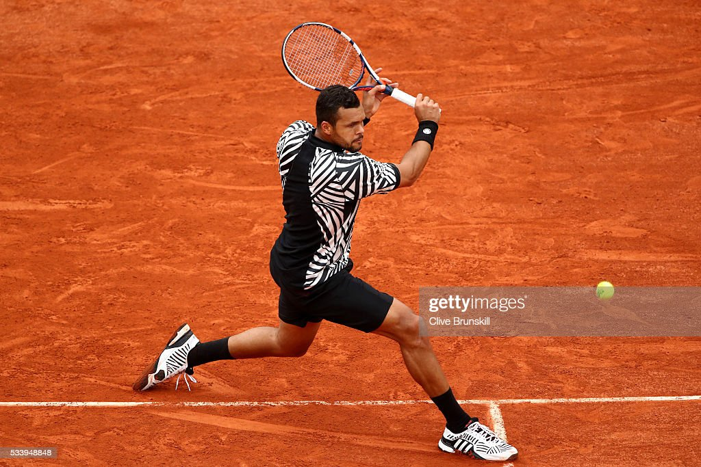Jo-Wilfried Tsonga of France plays a backhand during the Men's Singles first round match against Jan-Lennard Struff of Germany on day three of the 2016 French Open at Roland Garros on May 24, 2016 in Paris, France.