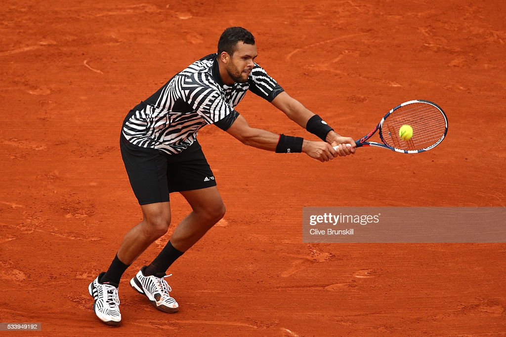 <a gi-track='captionPersonalityLinkClicked' href=/galleries/search?phrase=Jo-Wilfried+Tsonga&family=editorial&specificpeople=553803 ng-click='$event.stopPropagation()'>Jo-Wilfried Tsonga</a> of France plays a backhand during the Men's Singles first round match against Jan-Lennard Struff of Germany on day three of the 2016 French Open at Roland Garros on May 24, 2016 in Paris, France.