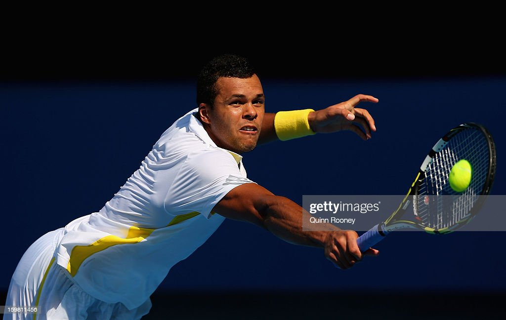 <a gi-track='captionPersonalityLinkClicked' href=/galleries/search?phrase=Jo-Wilfried+Tsonga&family=editorial&specificpeople=553803 ng-click='$event.stopPropagation()'>Jo-Wilfried Tsonga</a> of France plays a backhand in his fourth round match against Richard Gasquet of France during day eight of the 2013 Australian Open at Melbourne Park on January 21, 2013 in Melbourne, Australia.