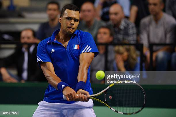 JoWilfried Tsonga of France plays a backhand in his match against Peter Gojowzyk of Germany during day 1 of the Davis Cup Quarter Final match between...