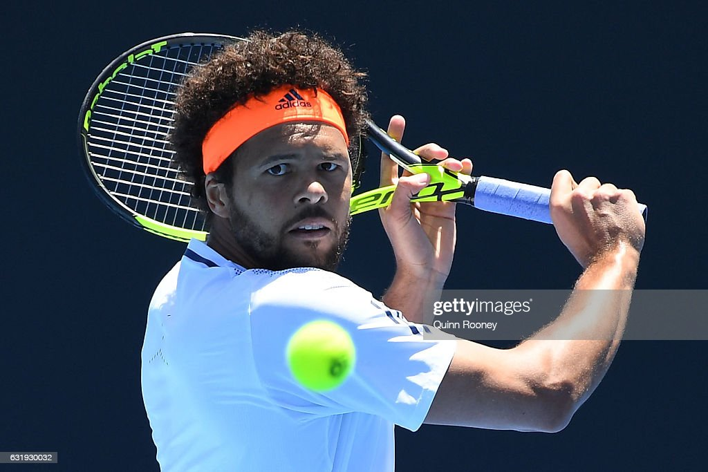 Jo-Wilfried Tsonga of France plays a backhand in his second round match against Dusan Lajovic of Serbia on day three of the 2017 Australian Open at Melbourne Park on January 18, 2017 in Melbourne, Australia.