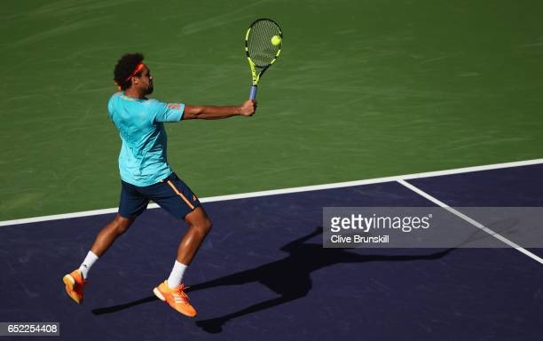 JoWilfried Tsonga of France plays a backhand volley against Fabio Fognini of Italy during day six of the BNP Paribas Open at Indian Wells Tennis...