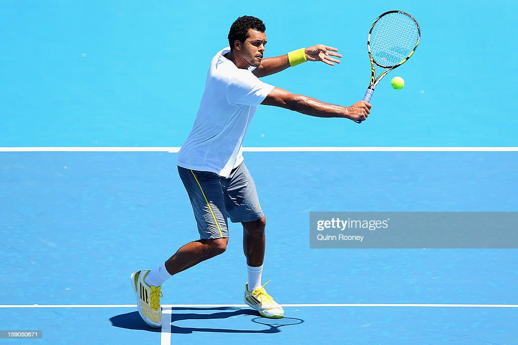 Jo-Wilfried Tsonga of France plays a backhand volley ahead of the 2013 Australian Open at Melbourne Park on January 7, 2013 in Melbourne, Australia.