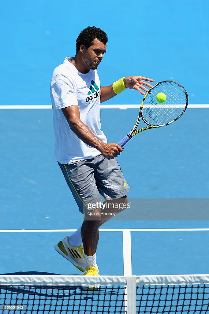 <a gi-track='captionPersonalityLinkClicked' href=/galleries/search?phrase=Jo-Wilfried+Tsonga&family=editorial&specificpeople=553803 ng-click='$event.stopPropagation()'>Jo-Wilfried Tsonga</a> of France plays a backhand volley ahead of the 2013 Australian Open at Melbourne Park on January 7, 2013 in Melbourne, Australia.