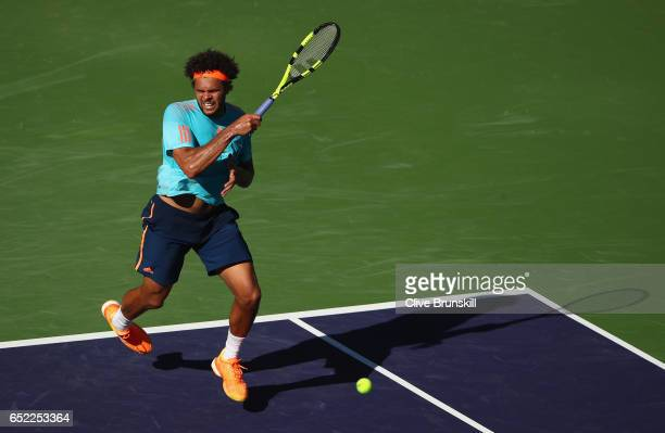 JoWilfried Tsonga of France plays a forehand against Fabio Fognini of Italy during day six of the BNP Paribas Open at Indian Wells Tennis Garden on...