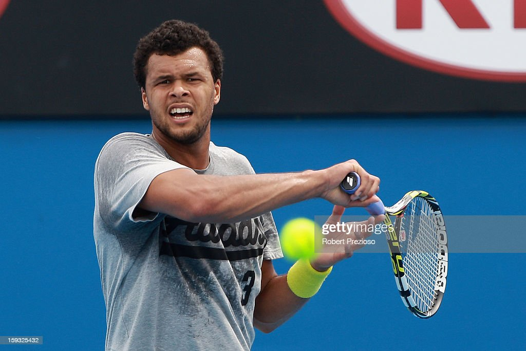Jo-Wilfried Tsonga of France plays a forehand ahead of the 2013 Australian Open at Melbourne Park on January 12, 2013 in Melbourne, Australia.