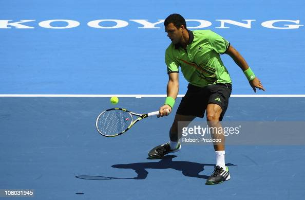 JoWilfried Tsonga of France plays a forehand during his match against Jurgen Melzer of Austria during day three of the AAMI Classic at Kooyong on...