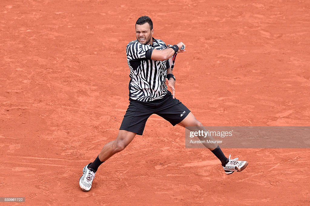 Jo-Wilfried Tsonga of France plays a forehand during his men's single first round match against Jan-Lennard Struff of Germany at Roland Garros on May 24, 2016 in Paris, France.