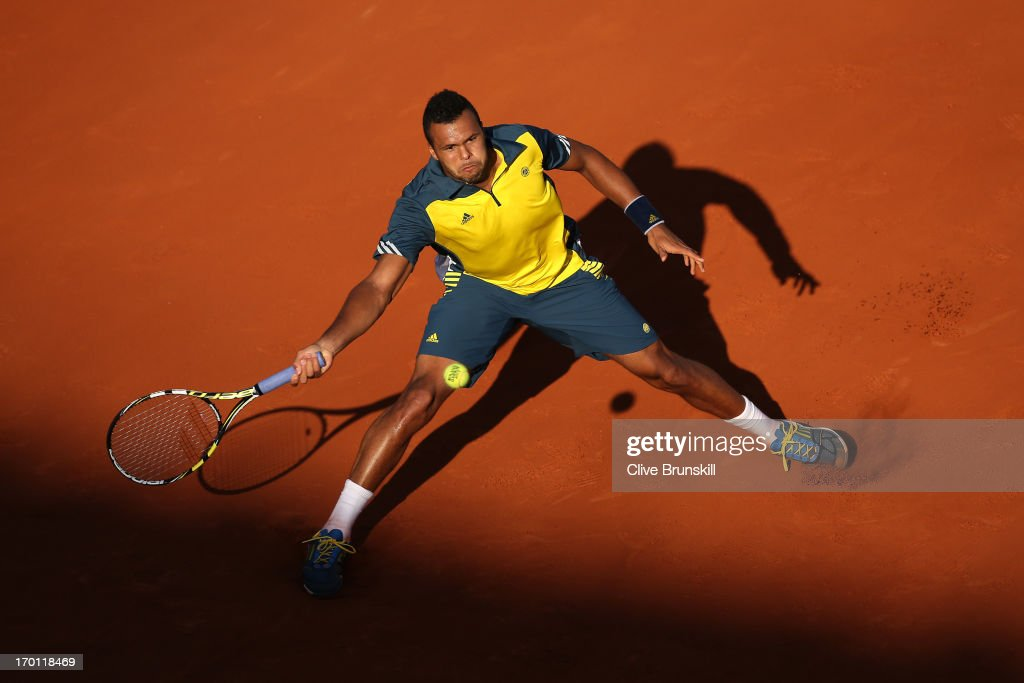 Jo-Wilfried Tsonga of France plays a forehand during the men's singles semi-final match against David Ferrer of Spain on day thirteen of the French Open at Roland Garros on June 7, 2013 in Paris, France.