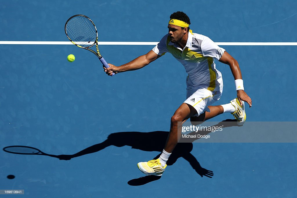 <a gi-track='captionPersonalityLinkClicked' href=/galleries/search?phrase=Jo-Wilfried+Tsonga&family=editorial&specificpeople=553803 ng-click='$event.stopPropagation()'>Jo-Wilfried Tsonga</a> of France plays a forehand in his first round match against Michael Llodra of France during day two of the 2013 Australian Open at Melbourne Park on January 15, 2013 in Melbourne, Australia.