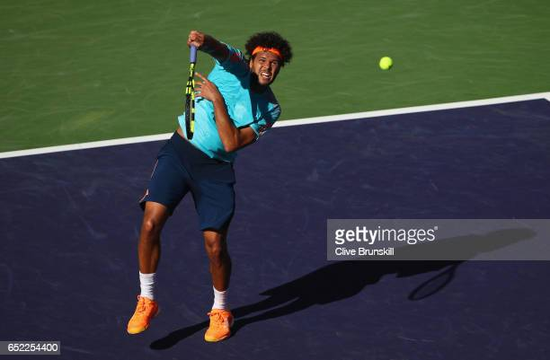 JoWilfried Tsonga of France plays a smash against Fabio Fognini of Italy during day six of the BNP Paribas Open at Indian Wells Tennis Garden on...