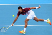 JoWilfried Tsonga of France plays forehand during his match against Jurgen Melzer of Austria during day one of the AAMI Classic at Kooyong on January...