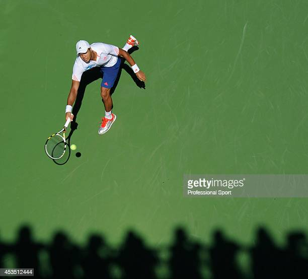 JoWilfried Tsonga of France plays running forehand return against Karol Beck of Slovakia during their men's singles first round match on Day Two of...