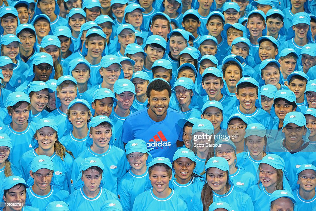 <a gi-track='captionPersonalityLinkClicked' href=/galleries/search?phrase=Jo-Wilfried+Tsonga&family=editorial&specificpeople=553803 ng-click='$event.stopPropagation()'>Jo-Wilfried Tsonga</a> of France poses with the squad of 380 Australian Open 2013 ballkids at the National Tennis Centre ahead of the 2013 Australian Open at Melbourne Park on January 8, 2013 in Melbourne, Australia. The squad includes 20 ballkids from Korea, 6 from China and 23 from interstate.